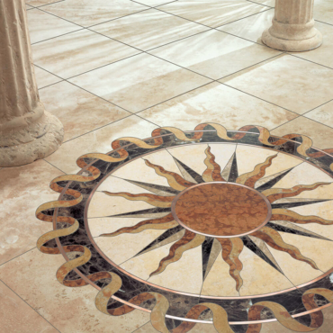 Helios Stone and Metal Medallion | Floor Medallion | Jerusalem Gold (Honed) Limestone, Emperador Dark Marble, Emperador Light Marble, Giallo Reale Marble, and Copper